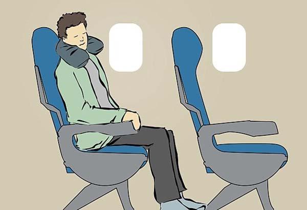 tư thế tốt nhất giúp bạn ngủ ngon trên máy bay